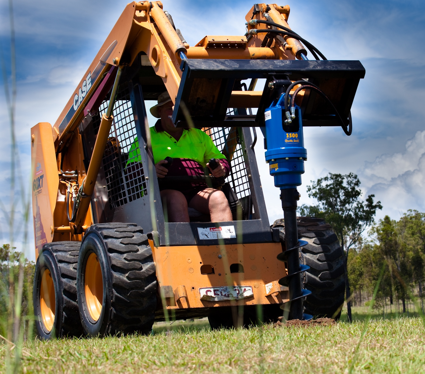 Case skidsteer with augertorque auger attachment